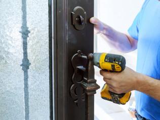 A handyman doing door installations in Waltham, MA